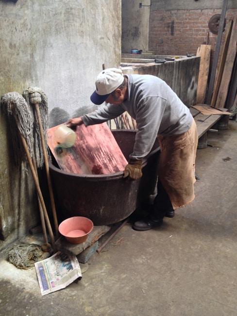 man washing copper