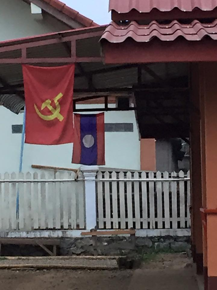 This outdoor gathering place looks like a Townhall. I noticed right away the communist flag and the Lao flag both flying.