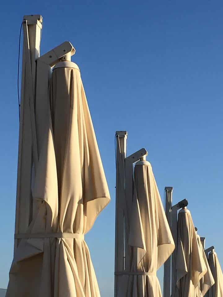 laura-davis-greece-chania-resting-umbrellas