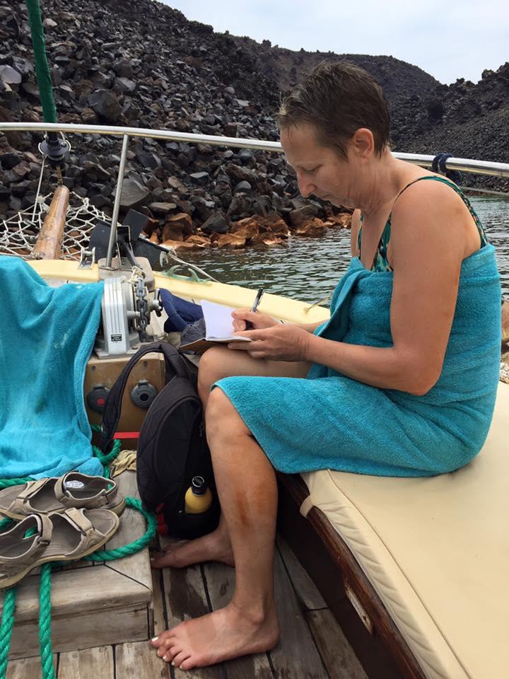 laura-davis-greece-santorini-laura-writing-on-deck