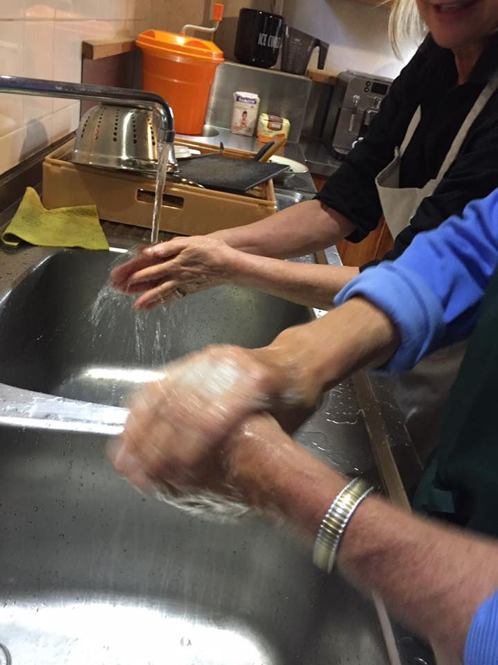 laura-davis-greece-milia-hand-washing