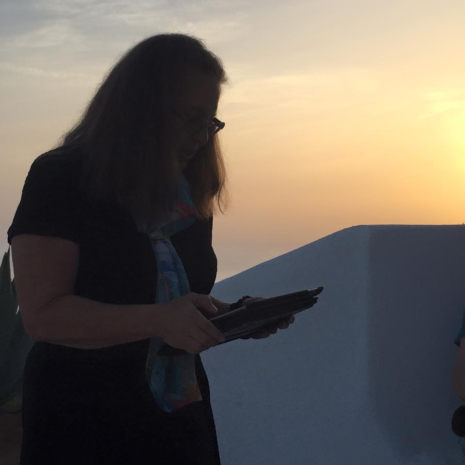 laura-davis-greece-reading-at-sunset